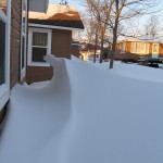 Snow drifts around the cabins at the resort